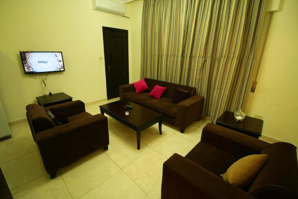 Aqarco bci apartments amman jordan for Living room amman