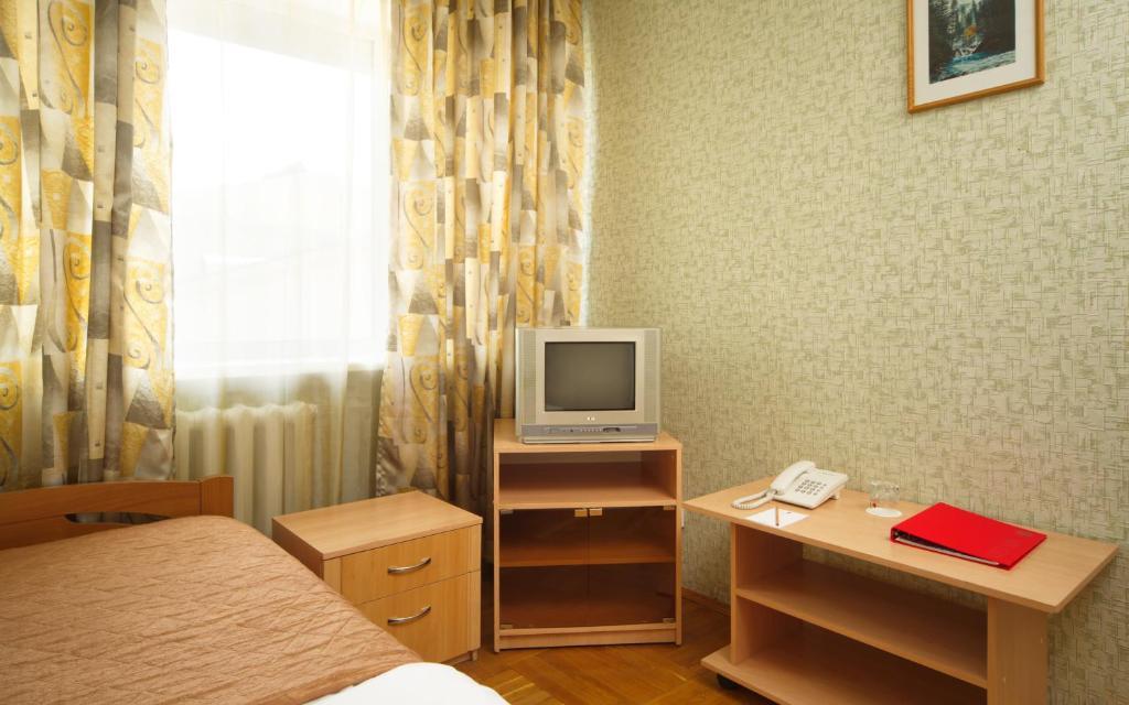 Телевизор и/или развлекательный центр в А Отель БРНО