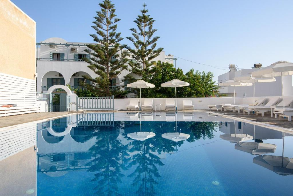 The swimming pool at or near Iris Boutique Hotel
