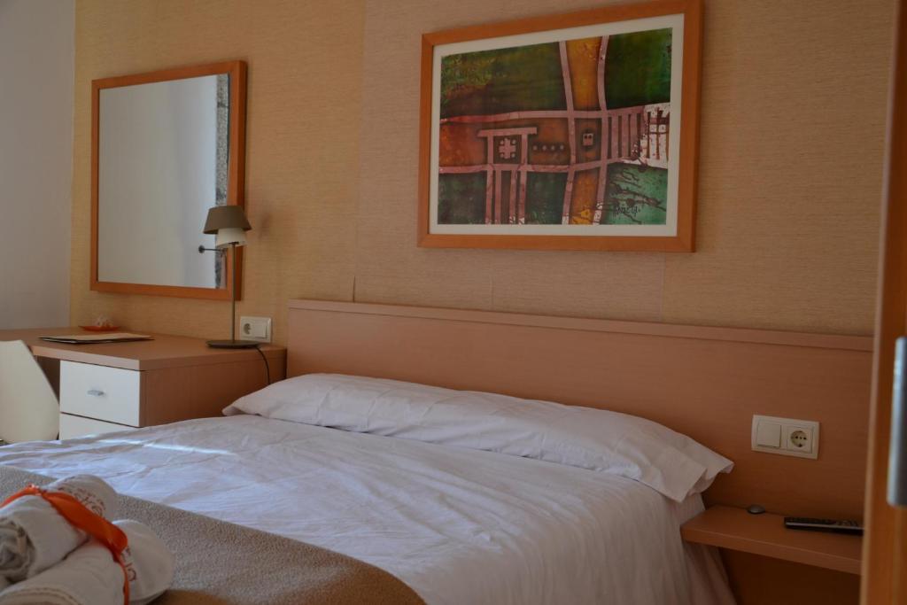 Ein Bett oder Betten in einem Zimmer der Unterkunft Pensión Da Estrela