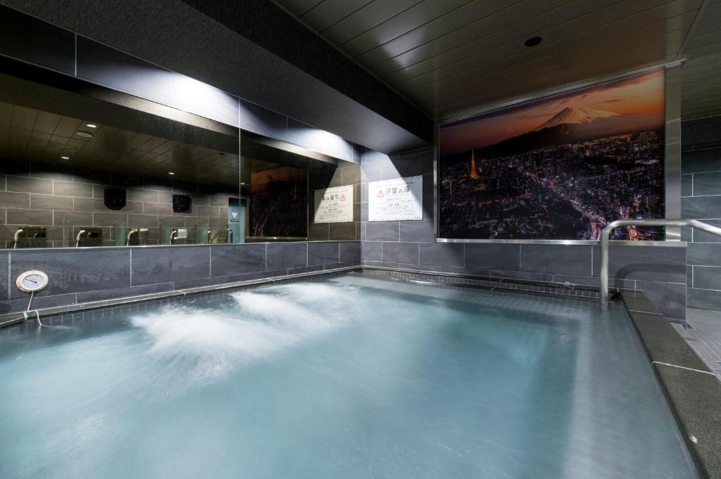 The swimming pool at or near Capsule Hotel Anshin Oyado Shinbashi Shiodome
