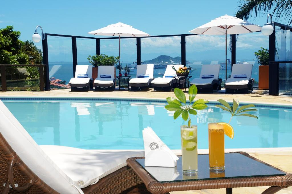 The swimming pool at or near Costa do Sol Boutique Hotel