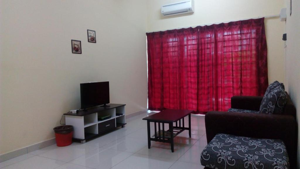 A Seating Area At Taiping Valuable Homestay