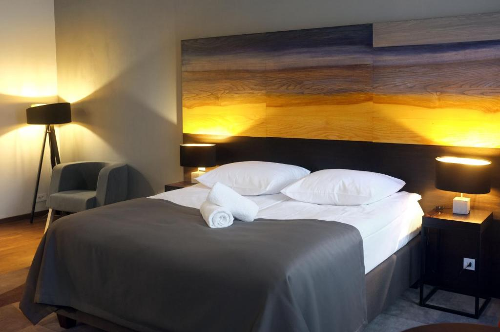 A bed or beds in a room at Dada Boutique Home Hotel
