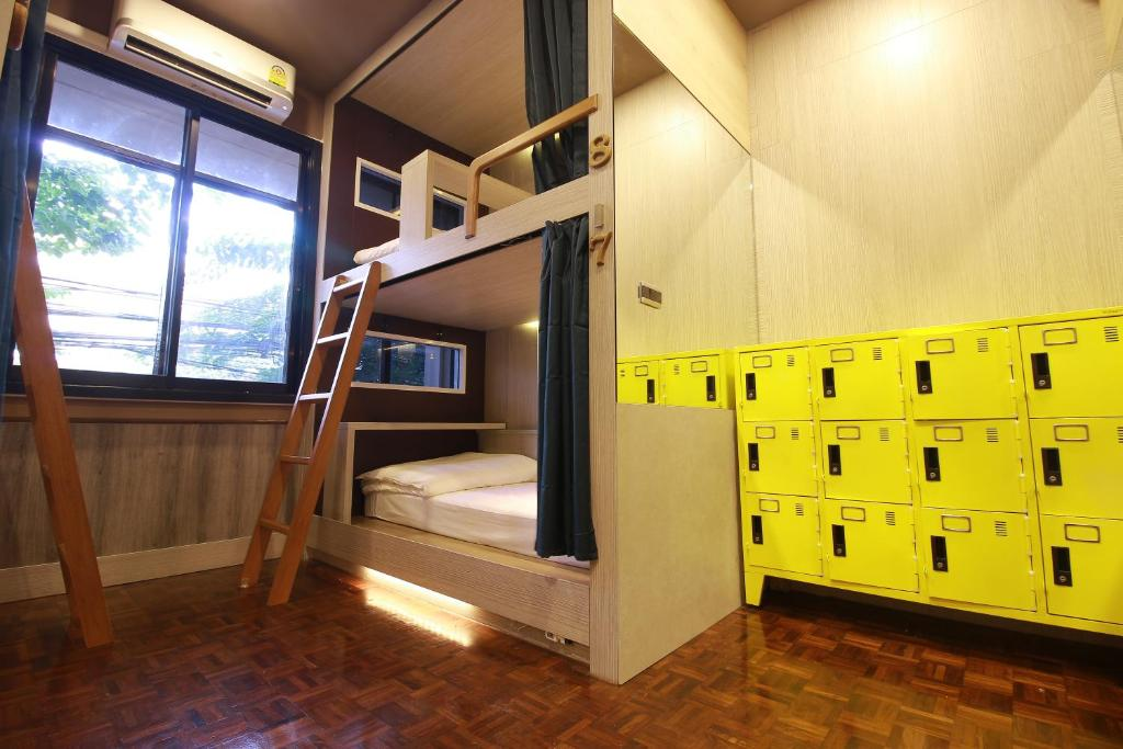 A bunk bed or bunk beds in a room at 168 Hostel