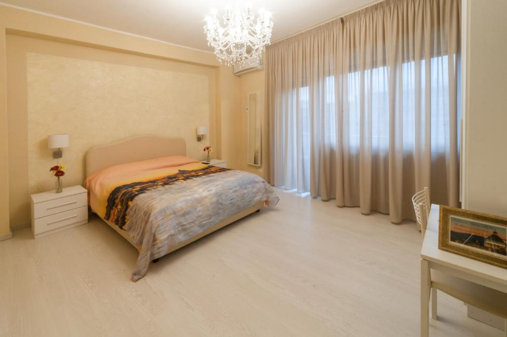 A bed or beds in a room at Vatican Skyline