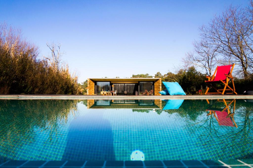 The swimming pool at or near Liiiving In Caminha | Lawny Pool House