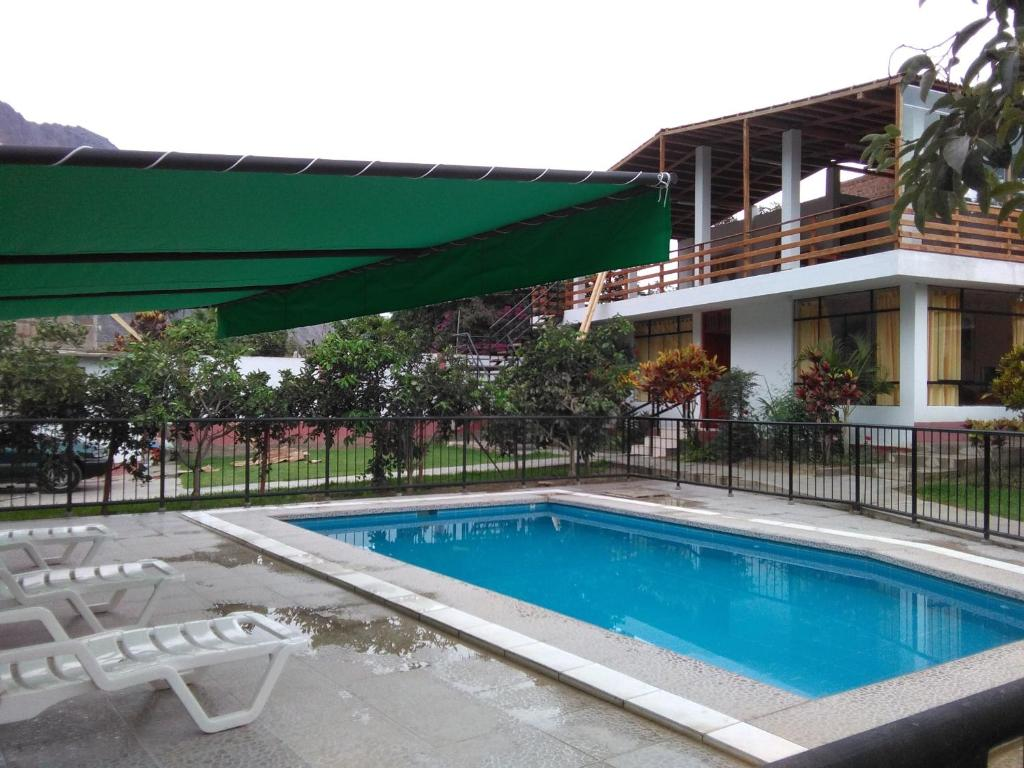 Casa de campo los faroles lunahuan peru for Booking casas
