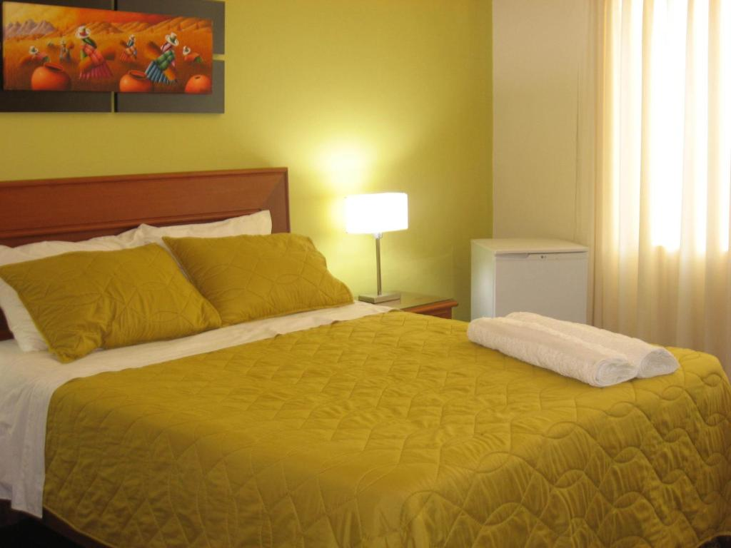 A bed or beds in a room at Sevilla House