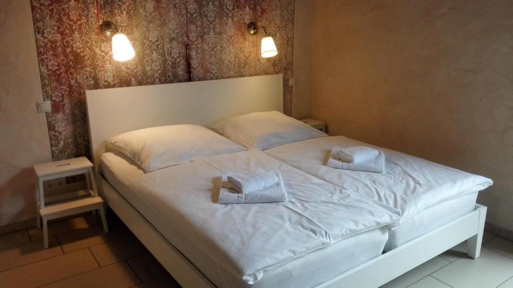 A bed or beds in a room at Hotel Pastis by Relax Inn