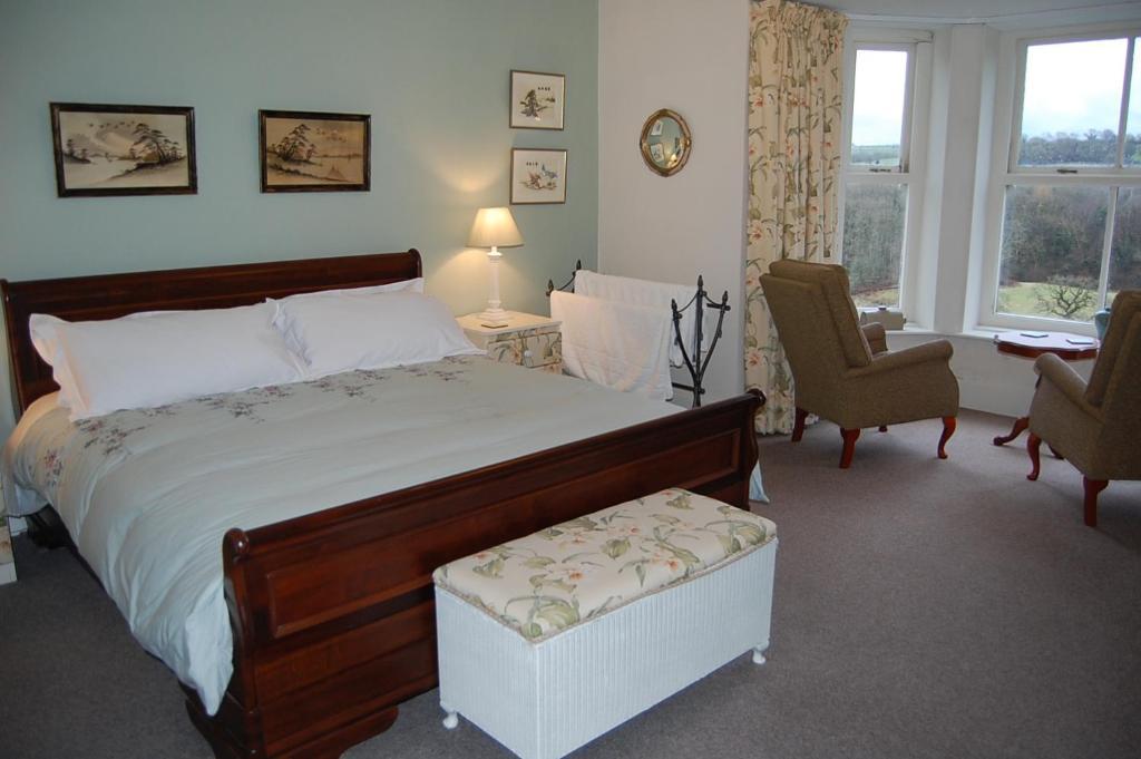 Posteľ alebo postele v izbe v ubytovaní Allt y Rheini Mansion