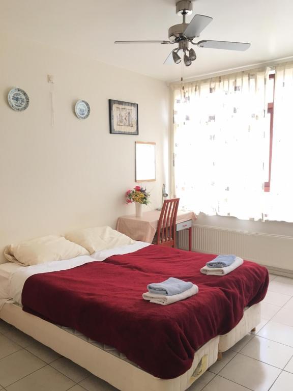 Cama o camas de una habitación en Lelylaan Guest House