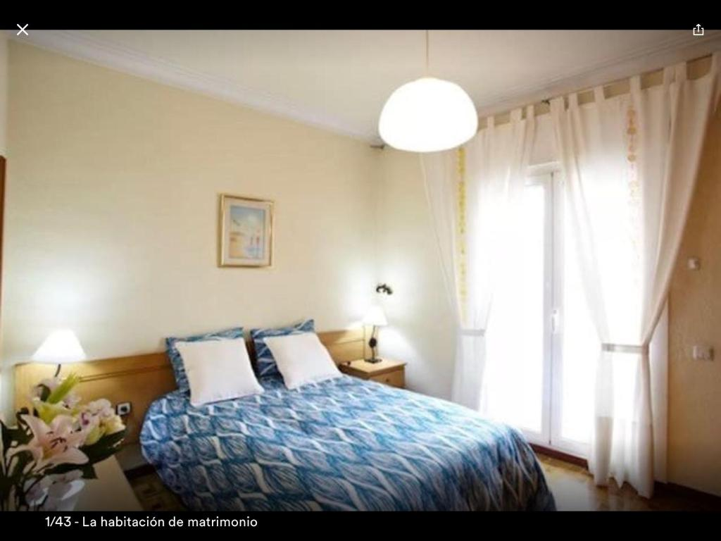 A bed or beds in a room at Lida's Holidays