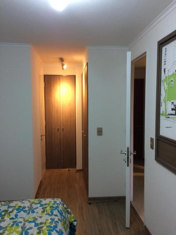 A bed or beds in a room at Departamento en Viña del Mar Céntrico