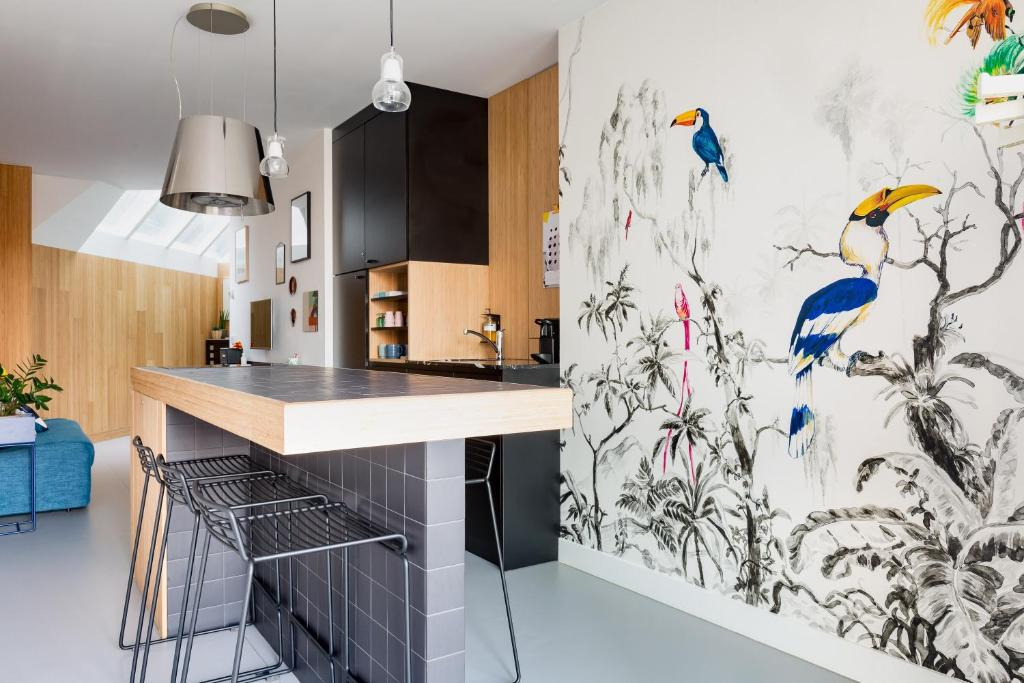 A kitchen or kitchenette at Kith & Kin Boutique Apartments