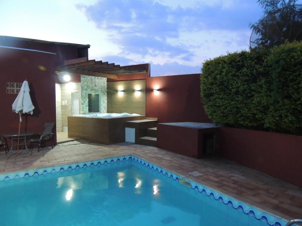 The swimming pool at or near Agape Hotel