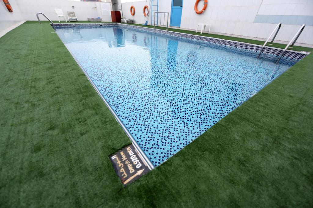 The swimming pool at or close to Signature INN Deira by Gemstones
