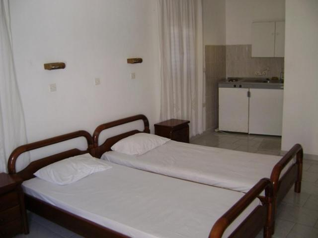 A bed or beds in a room at Valvi Irini Studios