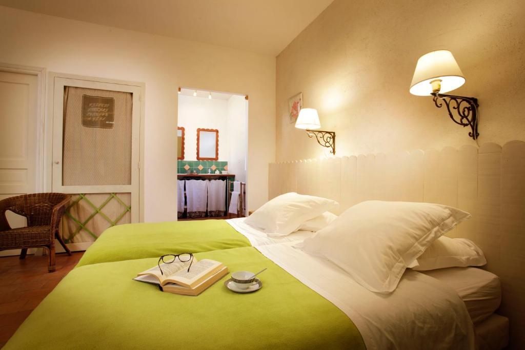Un ou plusieurs lits dans un hébergement de l'établissement Chambres d'Hôtes Logis de l'Astrée