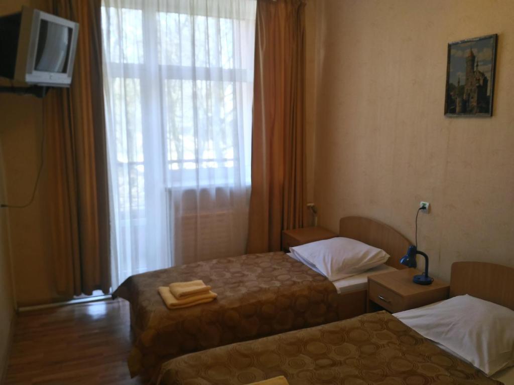 Кровать или кровати в номере Старый Дуб