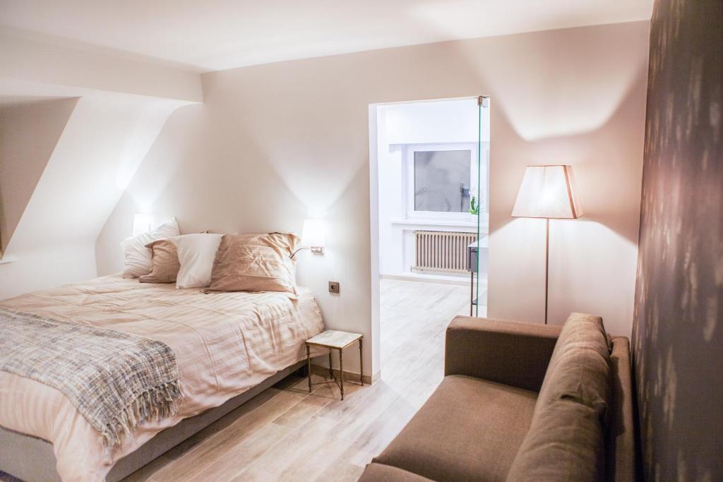 Ein Bett oder Betten in einem Zimmer der Unterkunft Sable d'O
