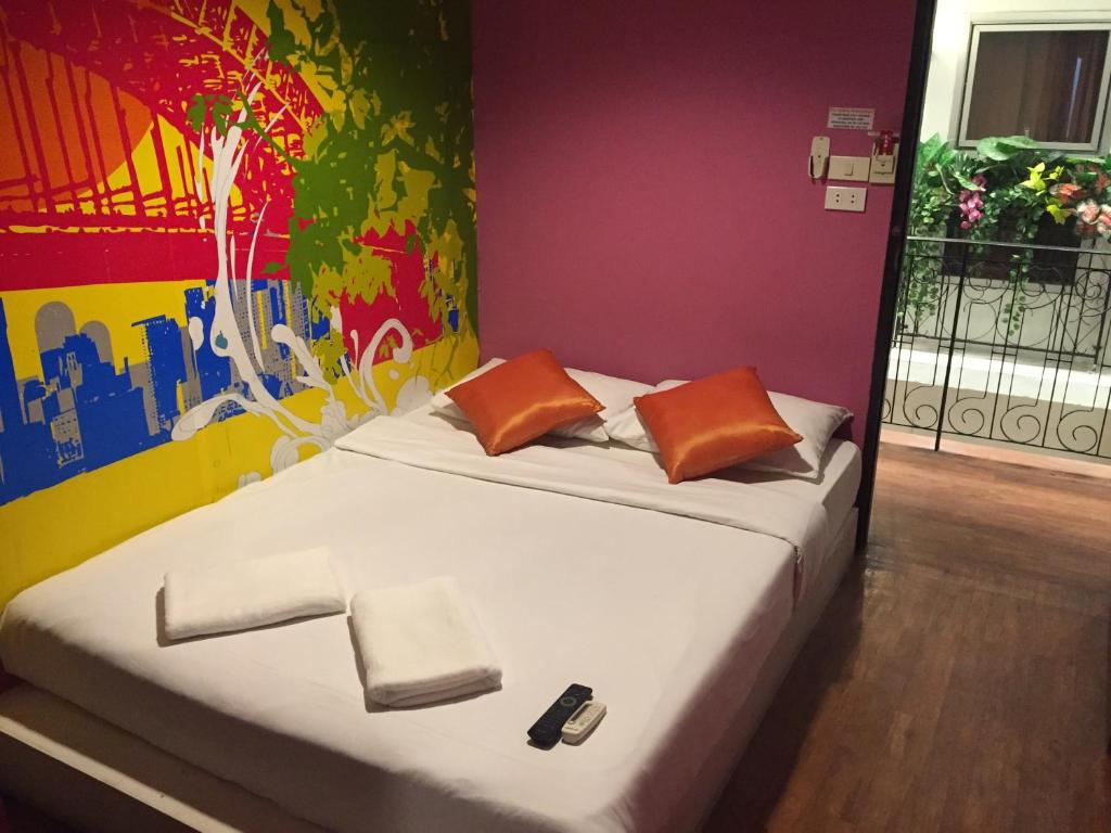 A bed or beds in a room at Take A Nap Hostel