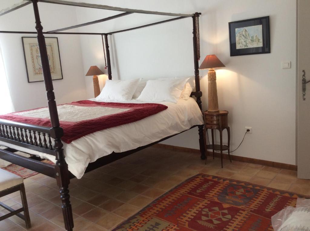 Un ou plusieurs lits dans un hébergement de l'établissement Atelier Soleil