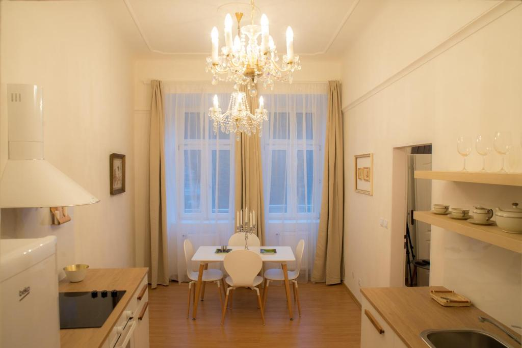A seating area at Prague Crystalette Apartment