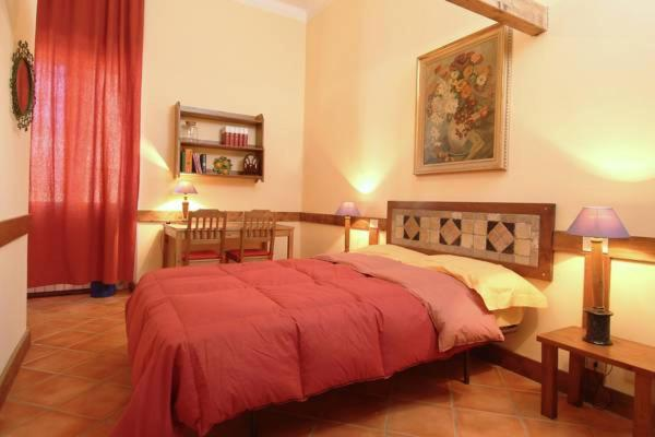 A bed or beds in a room at B&B Villa Rome