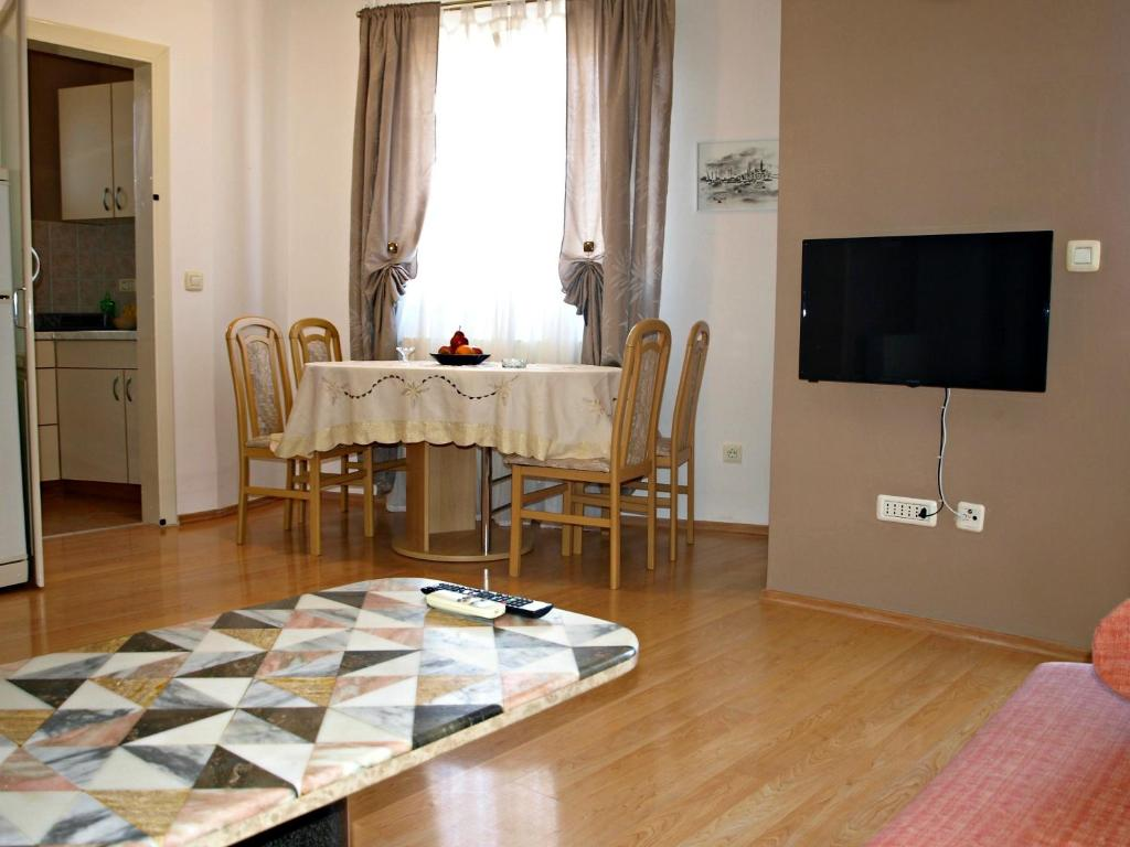A television and/or entertainment center at Apartment Jadranka