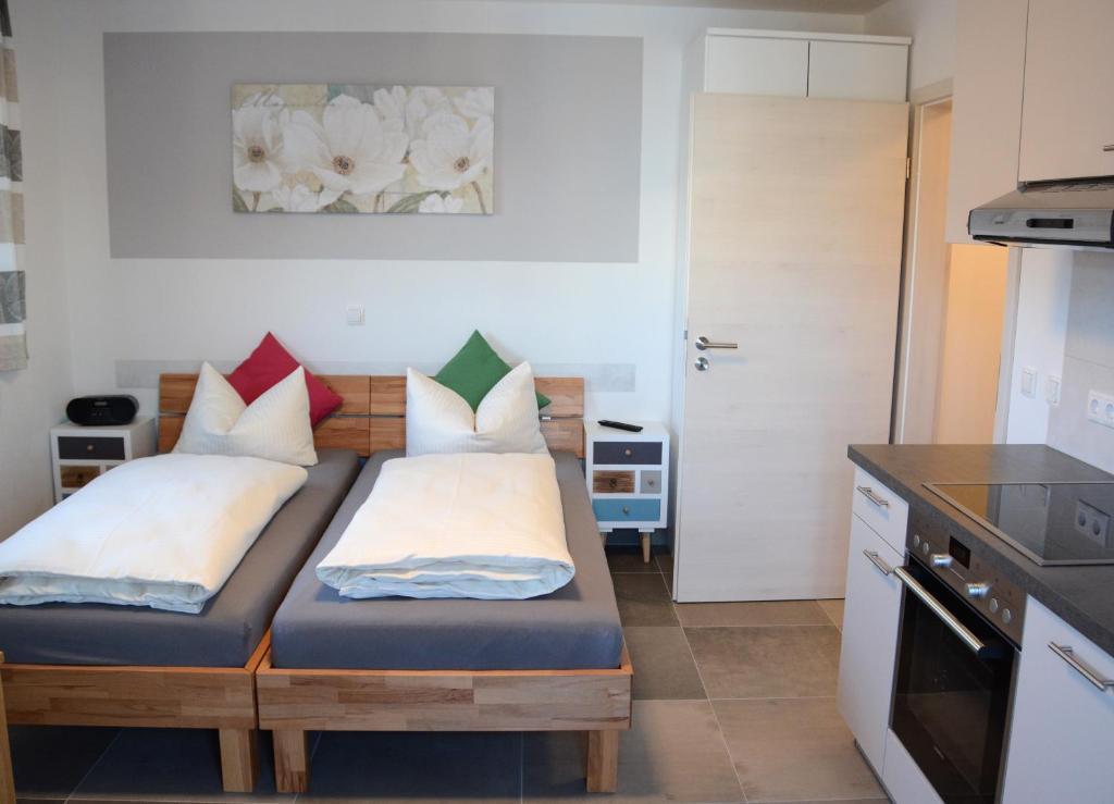 Letto o letti in una camera di Gästehaus Brunnerhof - Reisen