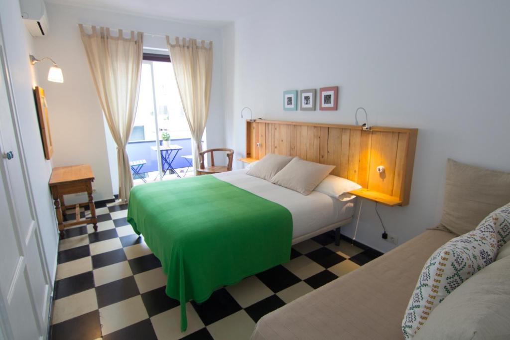 Postel nebo postele na pokoji v ubytování Hotel Finlandia