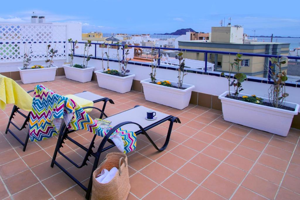 A balcony or terrace at Corralejo Center, by Comfortable Luxury