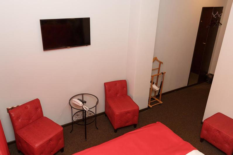 Телевизор и/или развлекательный центр в Отель Мартон на ВЛКСМ