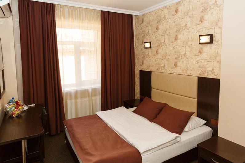 Кровать или кровати в номере Отель Мартон на ВЛКСМ
