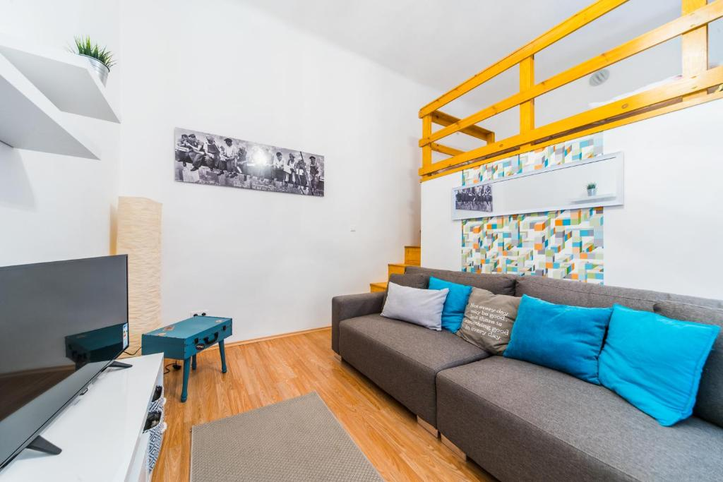 A seating area at Kazinczy 2 Bedroom Apartment