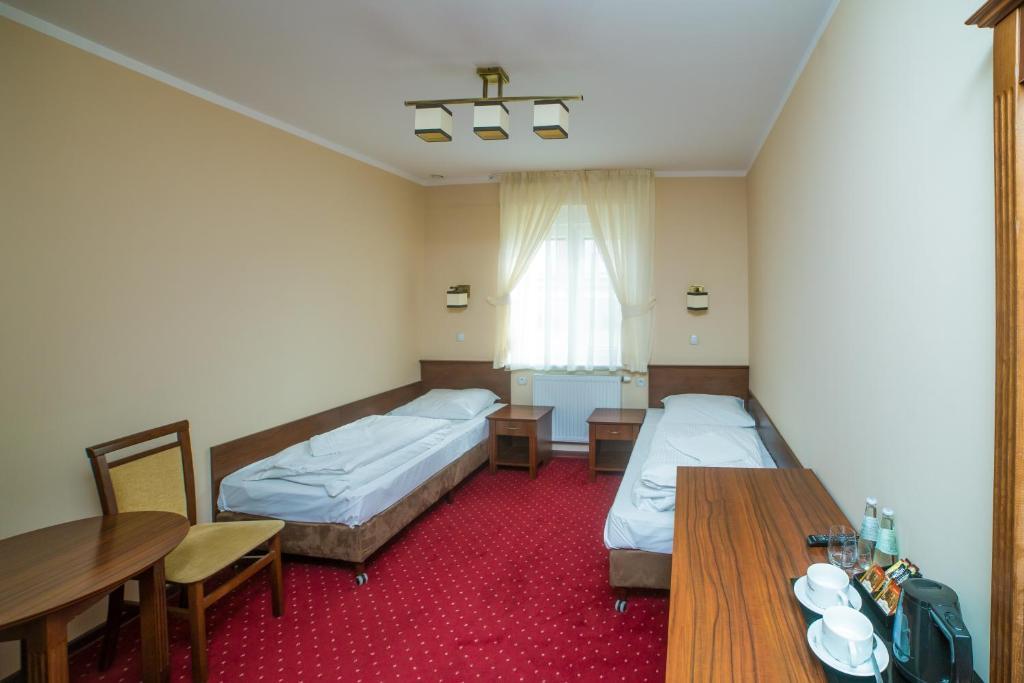 Łóżko lub łóżka w pokoju w obiekcie Motel Grant