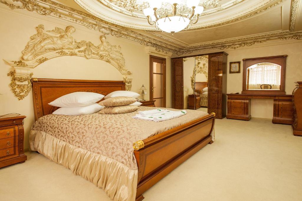Кровать или кровати в номере Изумруд