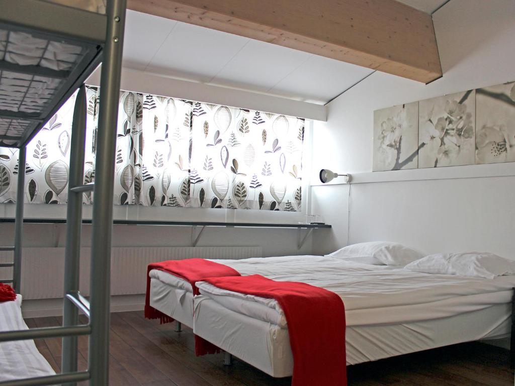 A bed or beds in a room at Mölletofta Wärdshus
