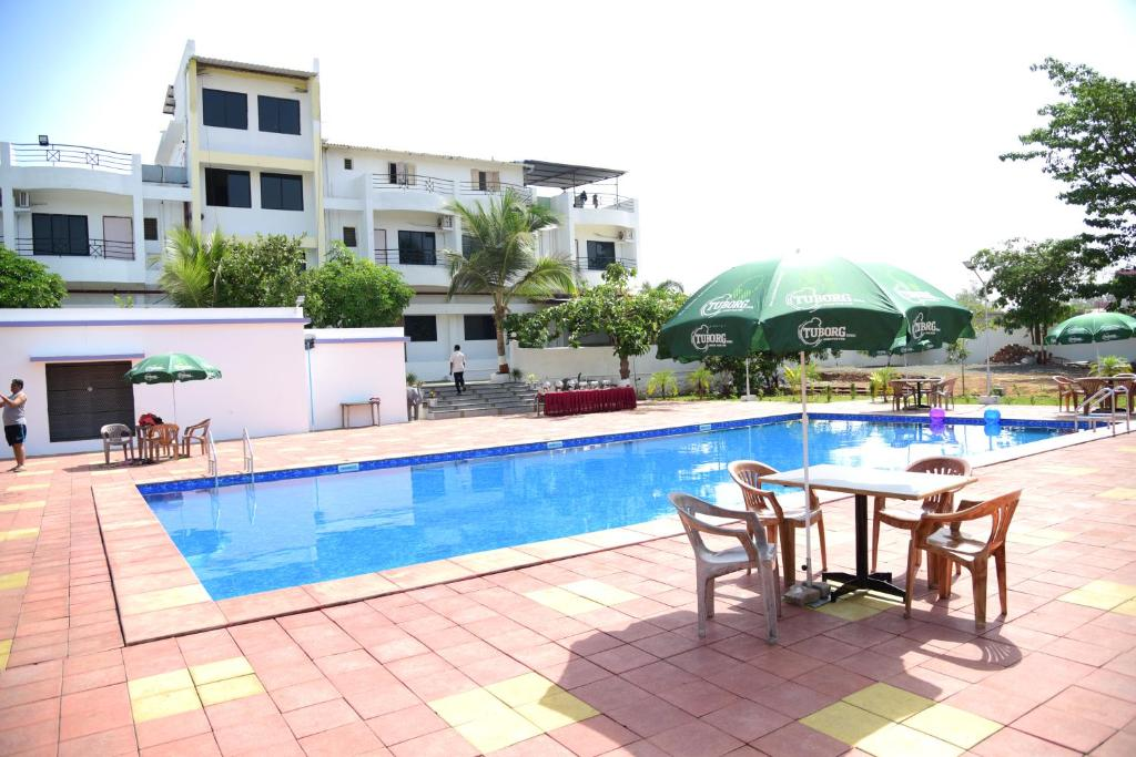 River touch resort silvassa india - Hotels in silvassa with swimming pool ...