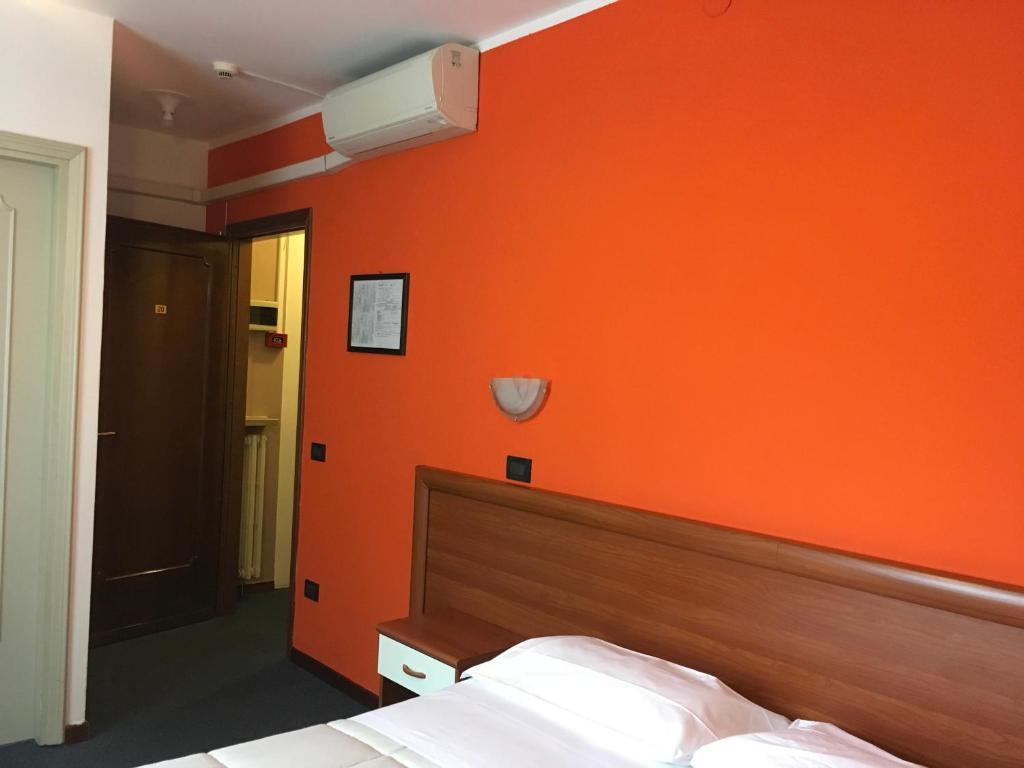 Postel nebo postele na pokoji v ubytování Hotel Cortina