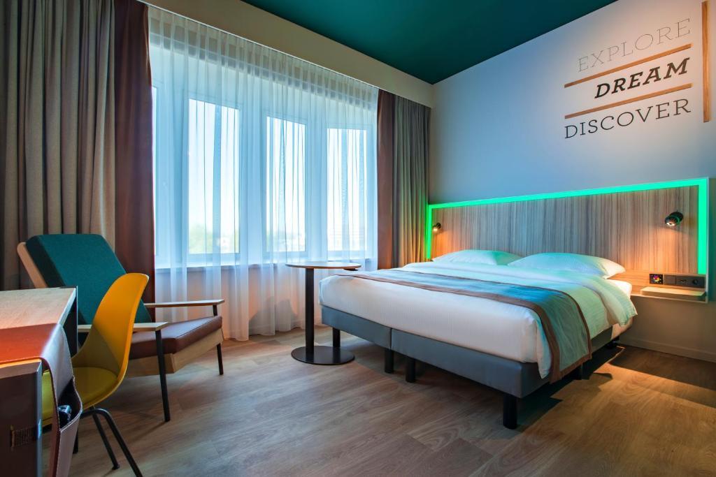 Кровать или кровати в номере Park Inn By Radisson Brussels Airport