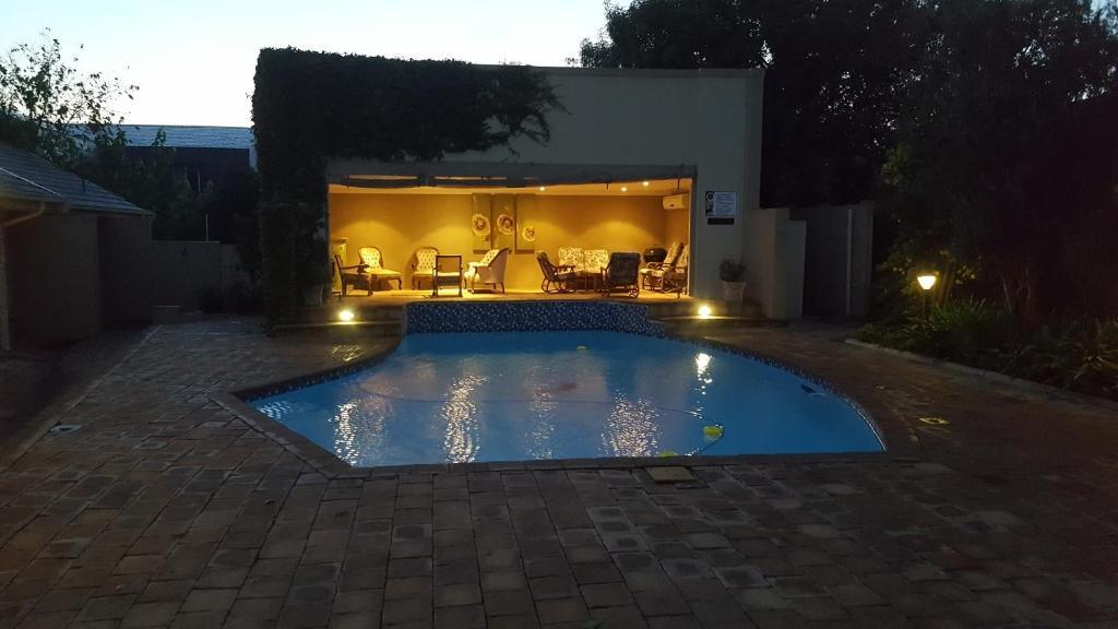 The swimming pool at or near Acacia Lodge