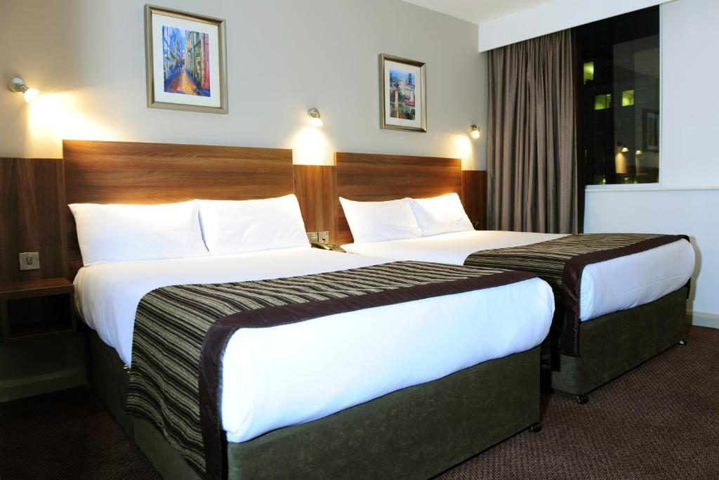 A bed or beds in a room at Jurys Inn Birmingham