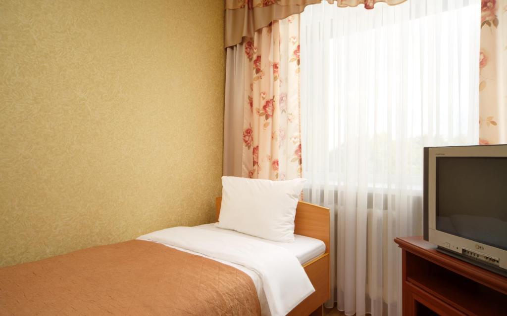 Кровать или кровати в номере А Отель БРНО