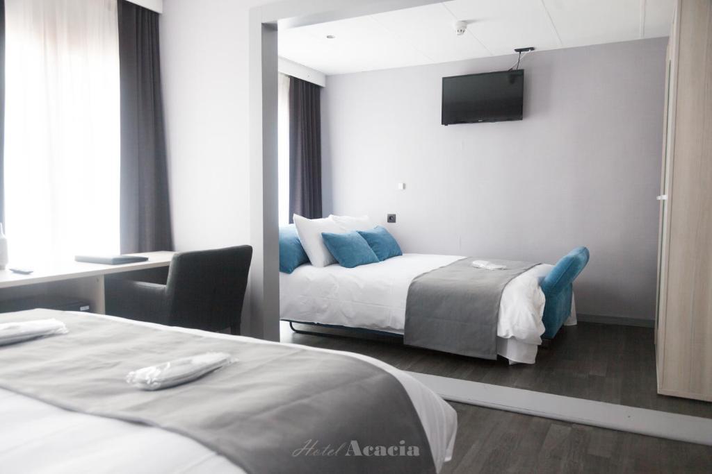 Krevet ili kreveti u jedinici u objektu Hotel Acacia