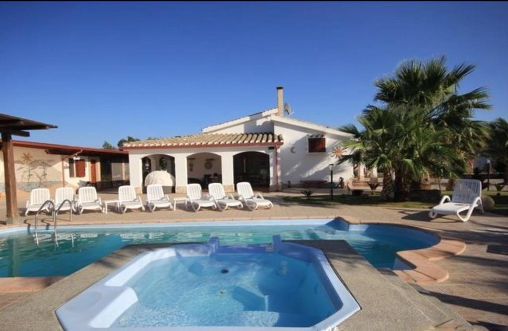 villa con piscina flumini di quartu prezzi aggiornati