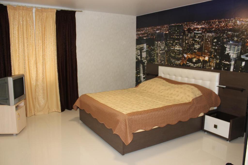 Кровать или кровати в номере Mini hotel S-House