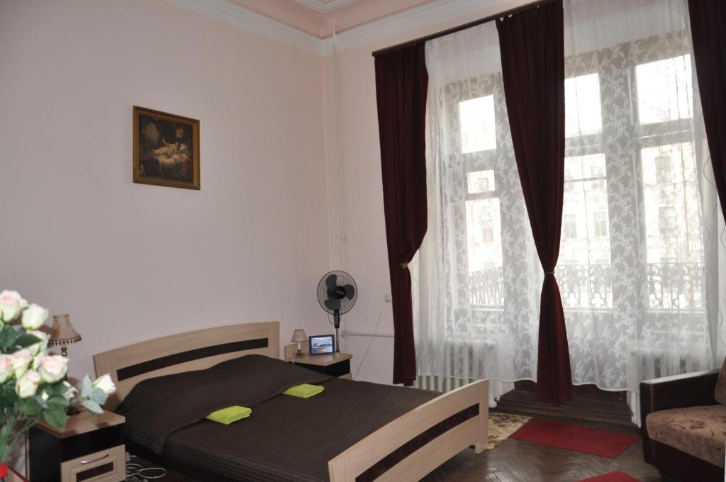 Кровать или кровати в номере Гостевой Дом Ксения