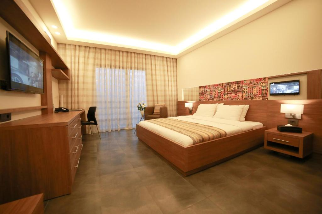 A bed or beds in a room at Urban Central Suites - Beirut